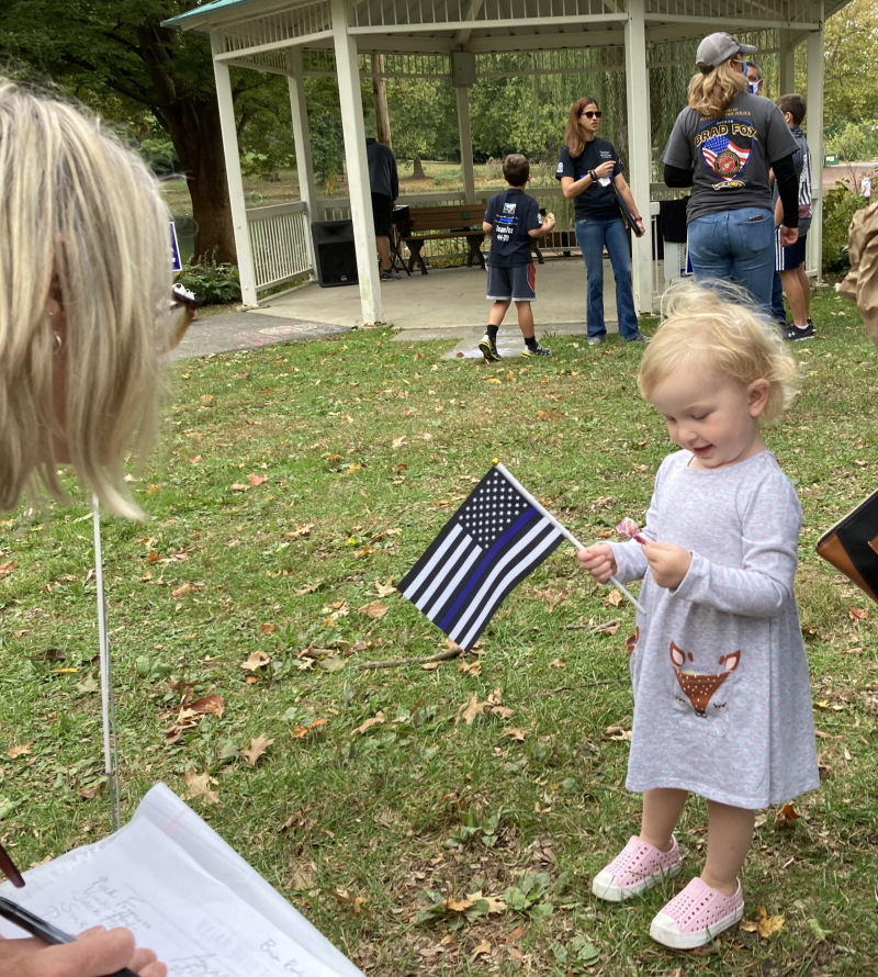 A-little-girl-with-a-back-the-blue-flag-at-springfield-township-rally_50446102426_o
