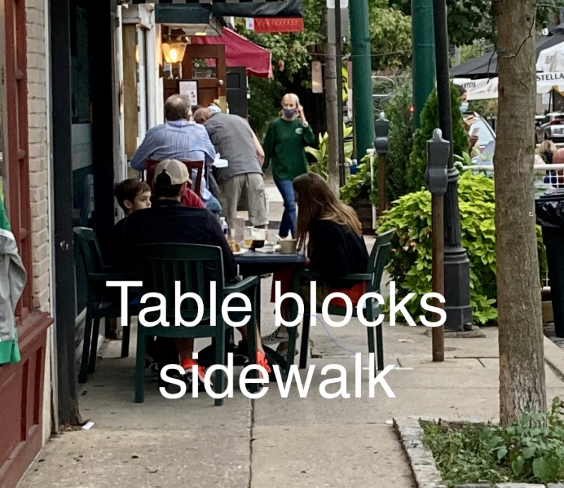 Mcnallys table blocks sidewalk